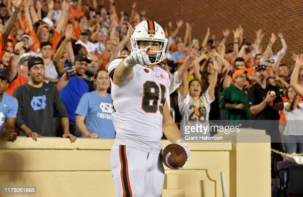 Will Mallory of the Miami Hurricanes reacts after scoring a touchdown against the North Carolina Tar Heels during the second half of their game at...