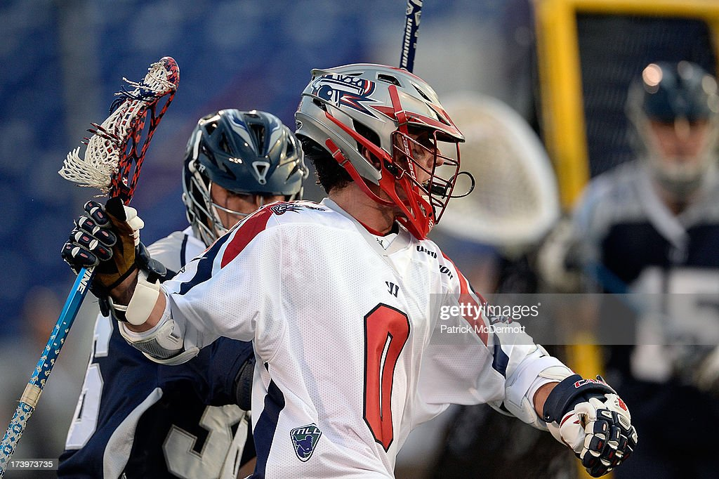 Will Manny #0 of Boston Cannons brings the ball around the net against the Chesapeake Bayhawks during the first hall of a game at Navy-Marine Corps Memorial Stadium on July 18, 2013 in Annapolis, Maryland.