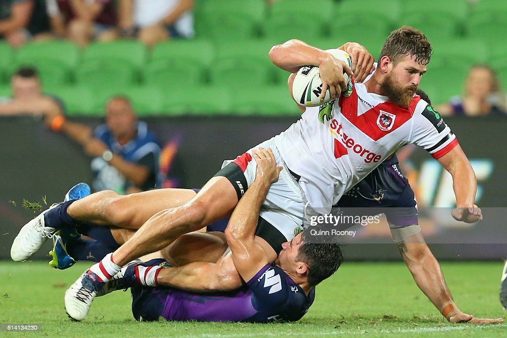 Will Matthews of the Dragons is tackled by Cooper Cronk of the Storm during the round one NRL match between the Melbourne Storm and the St George Illawarra Dragons at AAMI Park on March 7, 2016 in Melbourne, Australia.