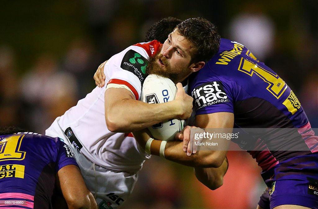 Will Matthews of the Dragons is tackled during the round 22 NRL match between the St George Illawarra Dragons and the Brisbane Bronocs at WIN Stadium on August 4, 2016 in Wollongong, Australia.