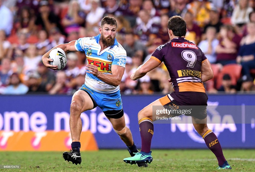 Will Matthews of the Titans takes on the defence during the round four NRL match between the Brisbane Broncos and the Gold Coast Titans at Suncorp Stadium on April 1, 2018 in Brisbane, Australia.