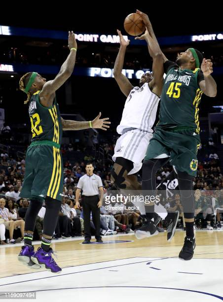 Will McDonald of Ball Hogs defends Frank Robinson of Enemies during week two of the BIG3 three on three basketball league at Spectrum Center on June...