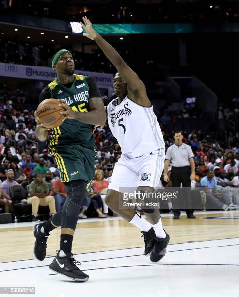 Will McDonald of Ball Hogs drives to the basket against Frank Robinson of Enemies during week two of the BIG3 three on three basketball league at...