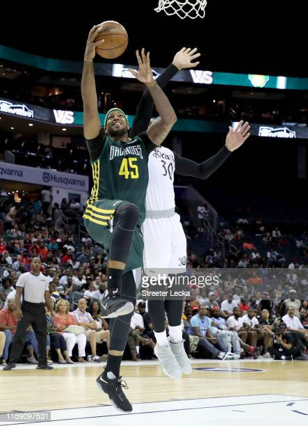 Will McDonald of Ball Hogs drives to the basket against Royce White of Enemies during week two of the BIG3 three on three basketball league at...