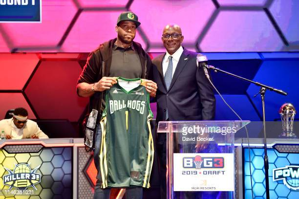 Will McDonald poses with BIG3 Commissioner Clyde Drexler after being drafted at by the Ball Hogs in the first round during the BIG3 Draft at the...