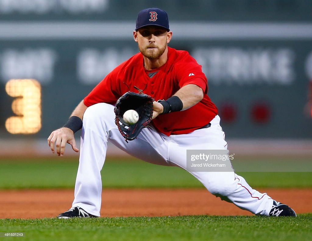 Will Middlebrooks #16 of the Boston Red Sox attempts to grab a ground ball in the first inning against the Detroit Tigers during the game at Fenway Park on May 16, 2014 in Boston, Massachusetts.