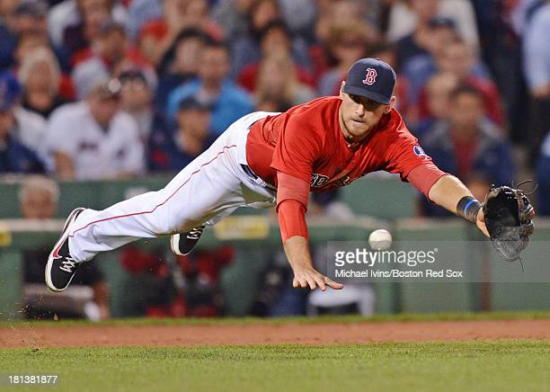 Will Middlebrooks of the Boston Red Sox dives for a ground ball against the Toronto Blue Jays in the fifth inning on September 20, 2013 at Fenway...