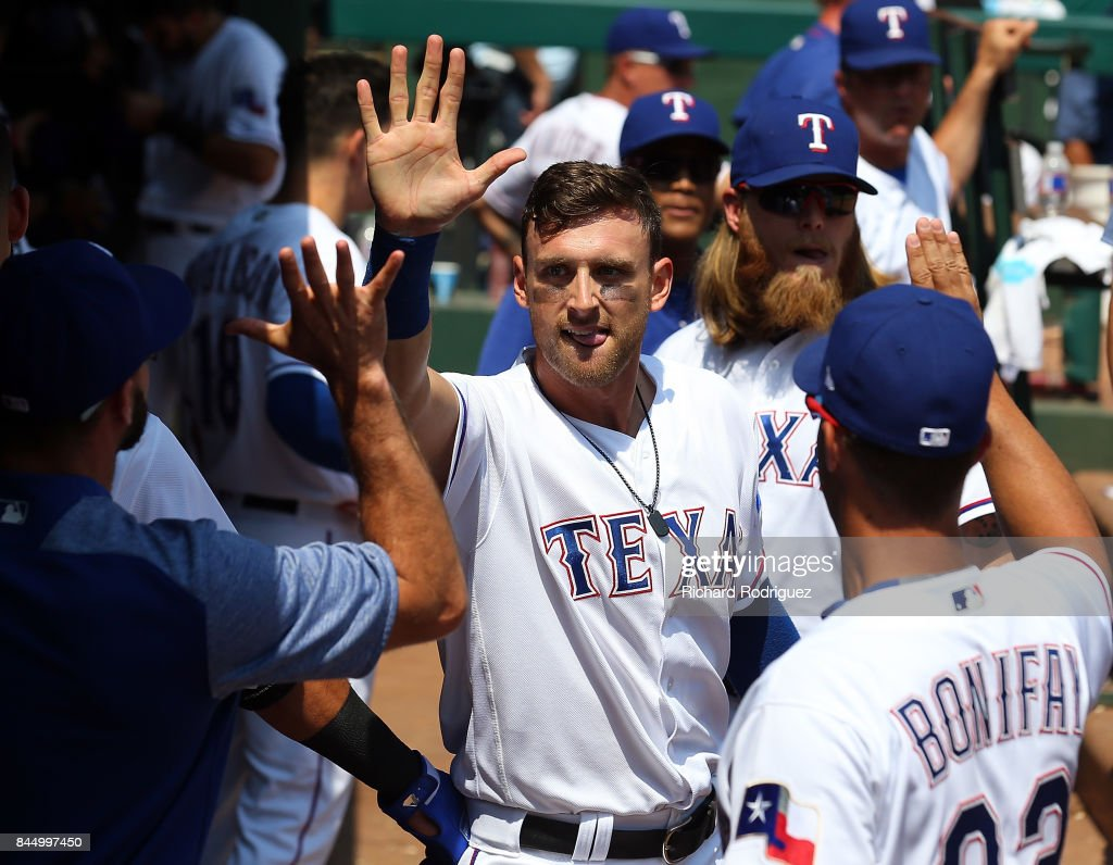 Will Middlebrooks #15 of the Texas Rangers gets high fives in the dugout after scoring in the 5th inning against the New York Yankees at Globe Life Park in Arlington on September 9, 2017 in Arlington, Texas.