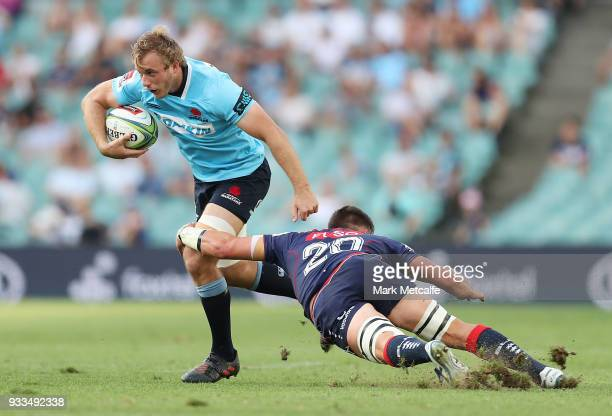 Will Miller of the Waratahs is tackled by Richard Hardwick of the Rebels during the round five Super Rugby match between the Waratahs and the Rebels...