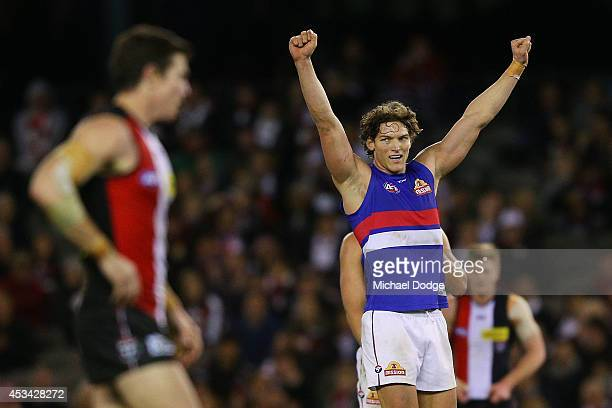 Will Minson of the Bulldogs celebrates victory on the siren next to Lenny Hayes of the Saints who played his last home game ever during the round 20...