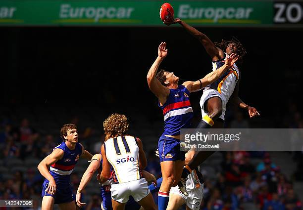Will Minson of the Bulldogs contests a centre bounce with Nick Naitanui of the Eagles during the round one AFL match between the Western Bulldogs and...