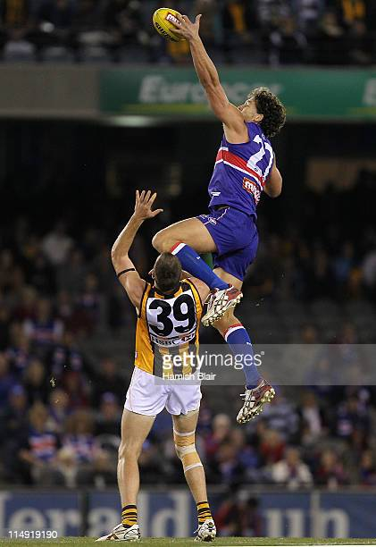Will Minson of the Bulldogs wins a ruck contests against Max Bailey of the Hawks during the round 10 AFL match between the Western Bulldogs and the...