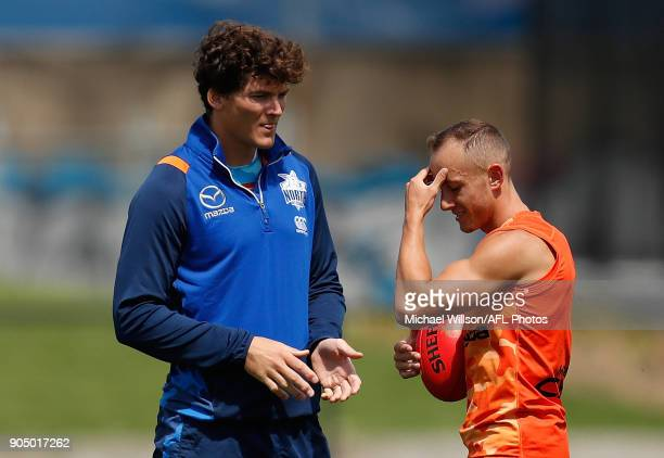 Will Minson Ruck Coach of the Kangaroos and Billy Hartung in action during a North Melbourne Kangaroos Training Session at Arden Street Ground on...