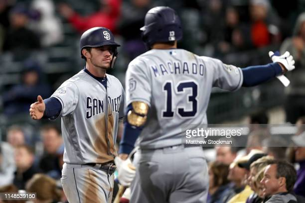 Will Myers of the San Diego Padres is congratulated by Manny Machado after scoring on a Greg Garcia RBI single in the ninth inning against the...