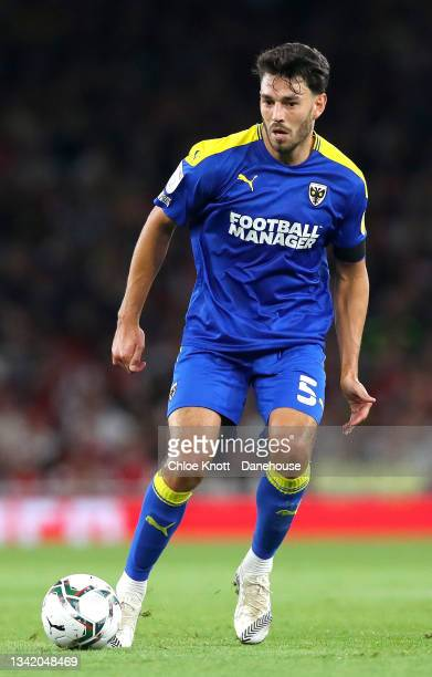 Will Nightingale of AFC Wimbledon controls the ball during the Carabao Cup Third Round match between Arsenal and AFC Wimbledon at Emirates Stadium on...