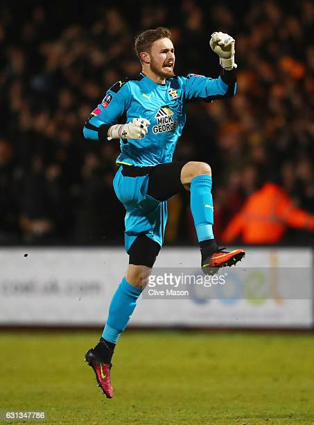 Will Norris of Cambridge United celebrates as Uche Ikpeazu of Cambridge United scores their first goal during the Emirates FA Cup Third Round match...