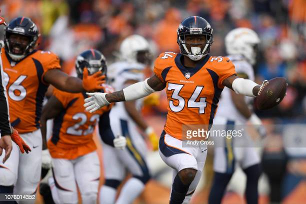 Will Parks of the Denver Broncos celebrates intercepting the ball during the first quarter The Denver Broncos hosted the Los Angeles Chargers at...
