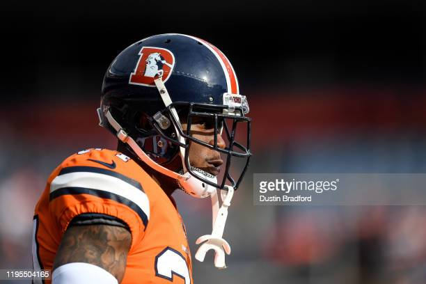 Will Parks of the Denver Broncos stands on the field as he warms up before a game against the Detroit Lions at Empower Field at Mile High on December...