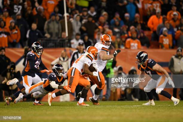 Will Parks of the Denver Broncos tackles Nick Chubb of the Cleveland Browns on fourth down during the fourth quarter The Denver Broncos hosted the...