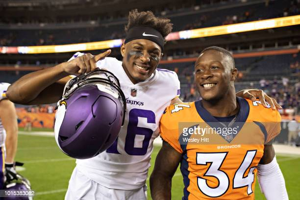 Will Parks of the Denver Broncos walks off the field with Cayleb Jones of the Minnesota Vikings after preseason week 1 at Broncos Stadium at Mile...