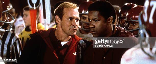 Will Patton looks to Denzel Washington in a scene form the film 'Remember The Titans' 2000
