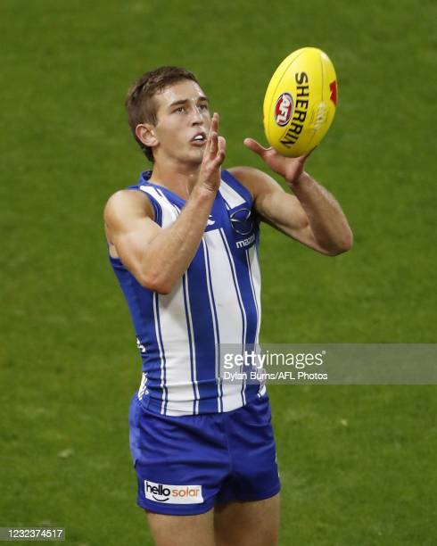 Will Phillips of the Kangaroos marks the ball during the 2021 AFL Round 05 match between the Geelong Cats and the North Melbourne Kangaroos at GMHBA...