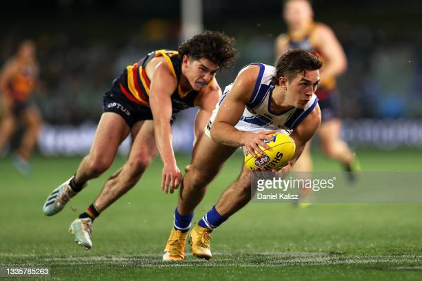 Will Phillips of the Kangaroos runs with the ball during the round 23 AFL match between Adelaide Crows and North Melbourne Kangaroos at Adelaide Oval...