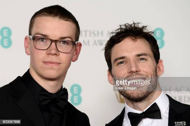 Will Poulter and Sam Claflin pose in the press room during the EE British Academy Film Awards held at Royal Albert Hall on February 18 2018 in London...