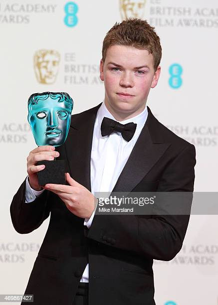 Will Poulter poses in the winners room at the EE British Academy Film Awards 2014 at The Royal Opera House on February 16 2014 in London England