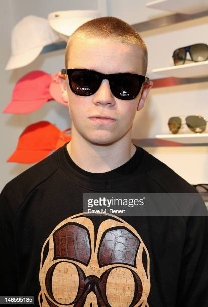 Will Poulter tries on sunglasses at the launch of Lacoste's new London Flagship store in Knightsbridge on June 20 2012 in London England