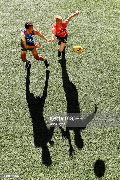 Will Powell and Connor Nutting compete for the ball during a Gold Coast Suns AFL training session at Metricon Stadium on June 6 2018 in Gold Coast...
