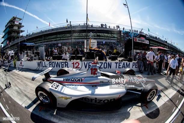 Will Power driver of the Team Penske Chevrolet car sits in the pit box before going to the grid prior to the running of the 102nd Indianapolis 500...