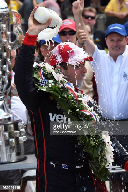 Will Power driver of the Team Penske Chevrolet celebrates in victory lane after winning the IndyCar Series Indianapolis 500 on May 27 at the...