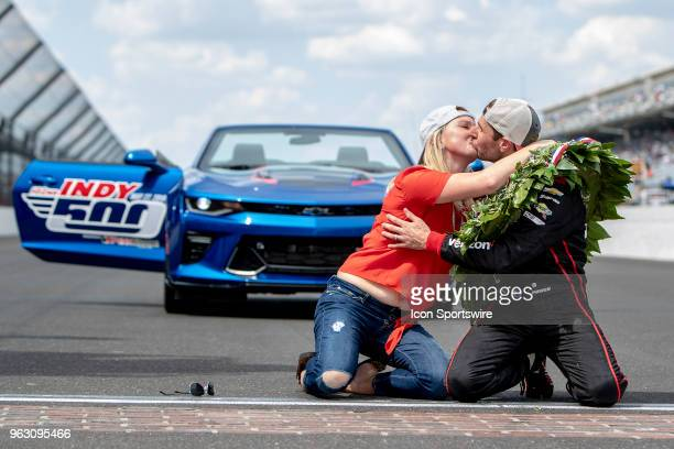 Will Power driver of the Team Penske Chevrolet kisses his wife Elizabeth Cannon after winning the 102nd Indianapolis 500 presented by Penn Grade...