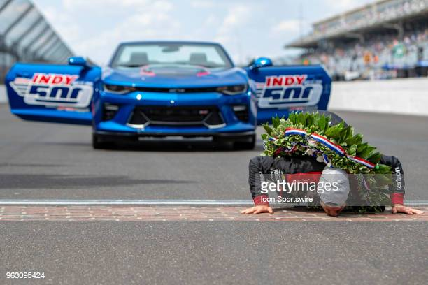 Will Power driver of the Team Penske Chevrolet kisses the bricks after winning the running of the 102nd Indianapolis 500 presented by Penn Grade...