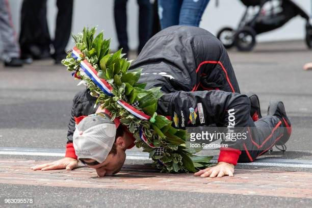 Will Power driver of the Team Penske Chevrolet kisses the bricks after winning the Indianapolis 500 on May 27 2018 at Indianapolis Motor Speedway in...