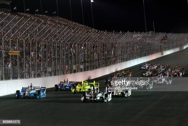 Will Power driver of the Team Penske Chevrolet leads the field into turn one for the start of the IndyCar Series Bommarito Automotive Group 500 on...
