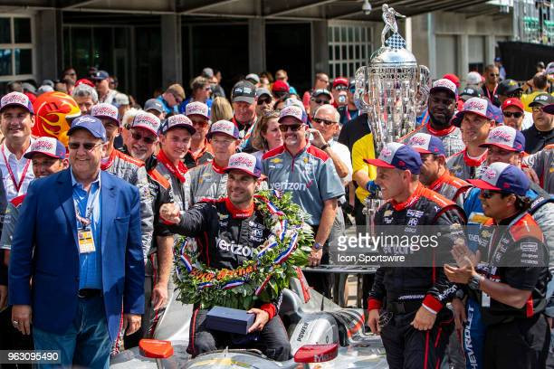 Will Power driver of the Team Penske Chevrolet shows off the ring in victory circle he won after winning the running of the 102nd Indianapolis 500...