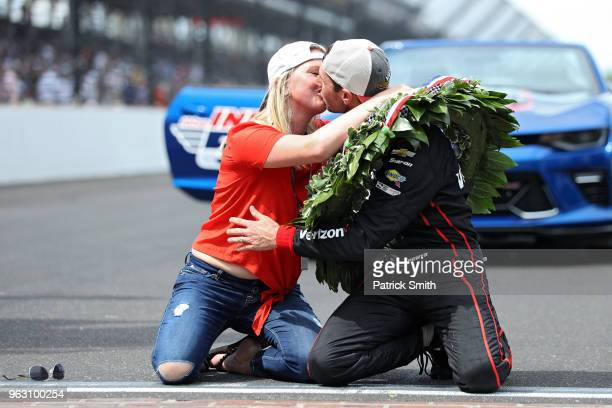 Will Power driver of the Verizon Team Penske Chevrolet celebrates as he kisses his wife Elizabeth Cannon after winning the 102nd Indianapolis 500 at...