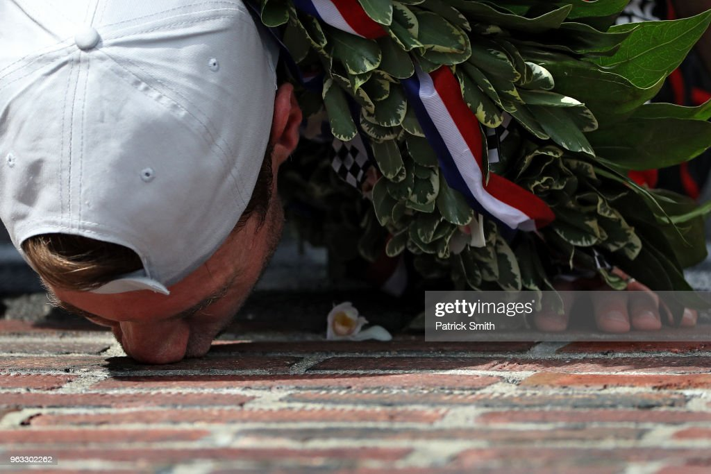 Will Power, driver of the #12 Verizon Team Penske Chevrolet, celebrates as he kisses the bricks after winning the 102nd Indianapolis 500 at Indianapolis Motorspeedway on May 27, 2018 in Indianapolis, Indiana.