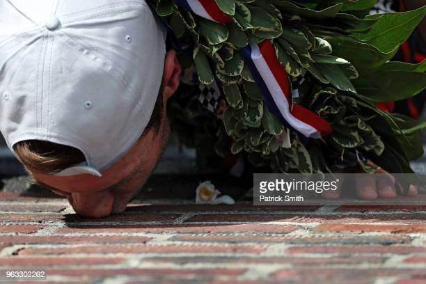 Will Power driver of the Verizon Team Penske Chevrolet celebrates as he kisses the bricks after winning the 102nd Indianapolis 500 at Indianapolis...