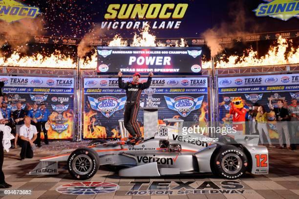 Will Power driver of the Verizon Team Penske Chevrolet celebrates in Victory Lane after winning the Verizon IndyCar Series Rainguard Water Sealers...