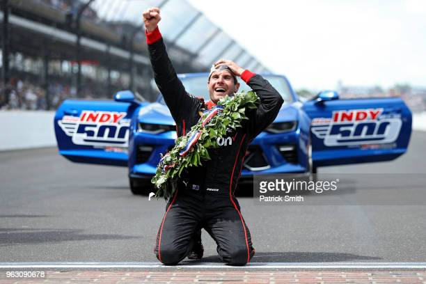 Will Power driver of the Verizon Team Penske Chevrolet celebrates after kissing the bricks and winning the 102nd Indianapolis 500 at Indianapolis...