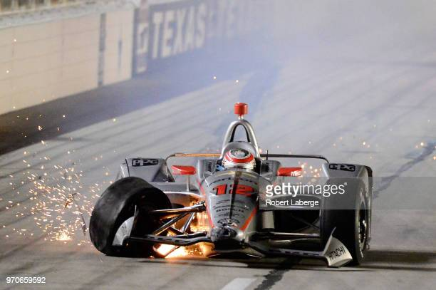 Will Power driver of the Verizon Team Penske Chevrolet crashes his car on the front stretch during the Verizon IndyCar Series DXC Technology 600 at...