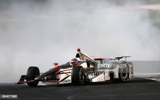 Will Power driver of the Verizon Team Penske Chevrolet does a burnout following his win in the Verizon IndyCar Series Rainguard Water Sealers 600 at...