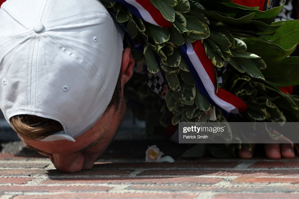 Will Power, driver of the #12 Verizon Team Penske Chevrolet, kisses the bricks after winning the 102nd Indianapolis 500 at Indianapolis Motorspeedway on May 27, 2018 in Indianapolis, Indiana.