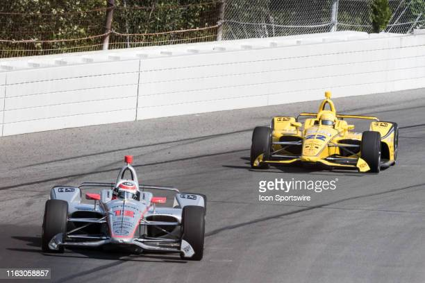 Will Power driver of the Verizon Team Penske Chevrolet leads Simon Pagenaud driver of the Team Penske Chevrolet into turn 2 during the ABC Supply 500...