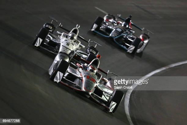 Will Power driver of the Verizon Team Penske Chevrolet leads Simon Pagenaud driver of the DXC Technology Team Penske Chevrolet during the Verizon...