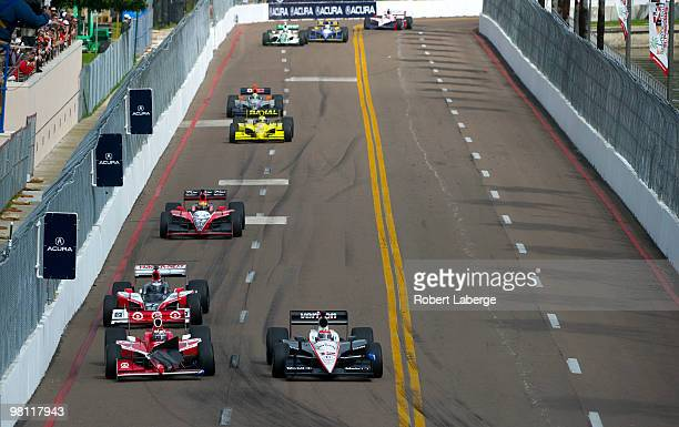 Will Power driver of the Verizon Team Penske Dallara Honda leads a pack of cars as Scott Dixon driver of the Target Chip Ganassi Dallara Honda drives...