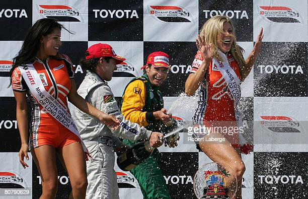 Will Power of Australia driver of the KV Racing Technology DP01 Ford Cosworth and Mario Dominguez of Mexico celebrate with champagne on the podium...